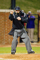 Home plate umpire Mike Cafaro makes a strike call during the game between the Liberty Flames and the High Point Panthers at Willard Stadium on March 23, 2013 in High Point, North Carolina.  The Panthers defeated the Flames 9-3.  (Brian Westerholt/Four Seam Images)