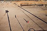 A Halliburton contractor walks near an oil well on a Goodrich Oil Co field  on the Burns Ranch near Dilley, Texas on Tuesday, January 3, 2012...Ben Sklar