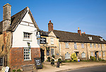 Historic houses and The George Inn at the  village of Lacock, Wiltshire, England, UK