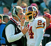 Landover, MD - October 23, 2005 -- Washington Redskins Assistant Head Coach (Defense) Gregg Williams, left, gives some instructions to right cornerback Shawn Springs (24),right, during the game against the San Francisco 49ers at FedEx Field in Landover, Maryland on October 23, 2005..Credit: Ron Sachs / CNP