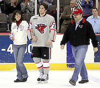 UNO senior Eric Olimb was joined by his parents Ann Meek and Roger Olimb for a ceremony honoring the team's seniors. Denver beat Nebraska-Omaha 4-2 Saturday night at Qwest Center Omaha. (Photo by Michelle Bishop)