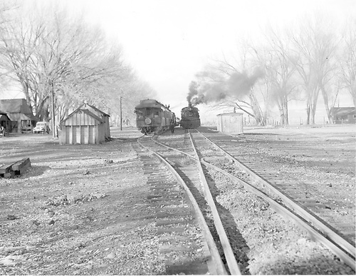 Eastbound &quot;San Juan&quot; in the hole (siding) at La Boca, CO. to let westbound freight train, headed by K-36 #488.  Station made from unused box car set on ground beside tracks.  Maintenance sheds beside siding.<br /> D&amp;RGW  La Boca, CO  Taken by Payne, Andy M. - 1/22/1951