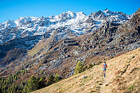 Running the Via Valais, a multi-day trail running tour connecting Verbier with Zermatt, Switzerland, with fresh snow on the mountains.