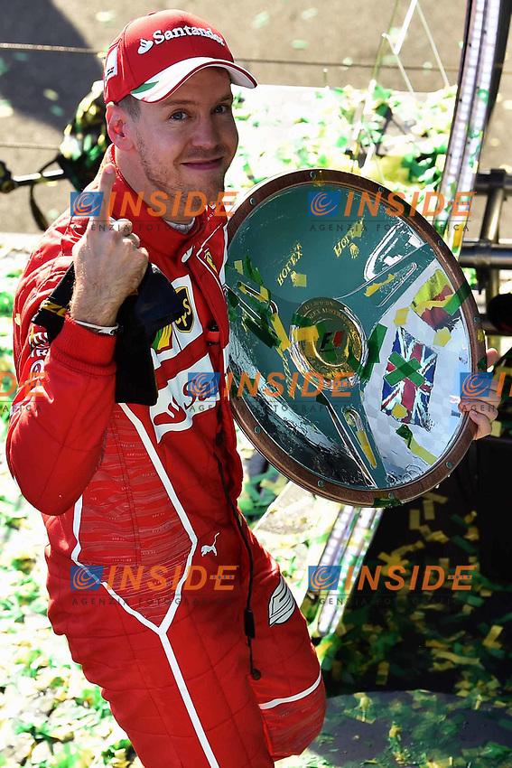 Race winner Sebastian Vettel (GER) Ferrari celebrates with the trophy on the podium at Formula One World Championship, Rd1, Australian Grand Prix, Race, Albert Park, Melbourne, Australia, Sunday 26 March 2017.<br /> Foto Sutton/Panoramic/Insidefoto