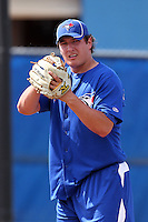 Toronto Blue Jays pitcher Asher Wojciechowski #60 throws in the bullpen during minor league practice at the Englebert Minor League Complex on February 27, 2012 in Dunedin, Florida.  (Mike Janes/Four Seam Images)