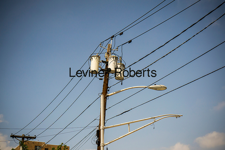 Electrical transmission lines and pole mounted transformers  in Jersey City, NJ on Saturday, July 18, 2015. (© Richard B. Levine)