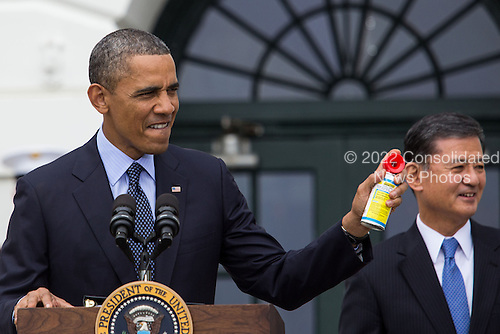 United States President Barack Obama, with U.S. Secretary of Veterans Affairs Secretary Eric Shinseki looking on at right, blows an air horn during a ceremony to welcome the Wounded Warrior Project's Soldier Ride to the White House in celebration of the seventh annual Soldier Ride, Wednesday, April 17, 2013, on the South Lawn of the White House in Washington. .Credit: Drew Angerer / Pool via CNP