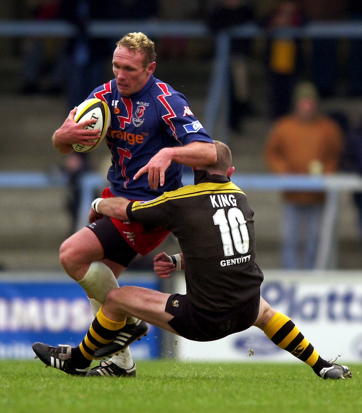 Photo. Richard Lane. .London Wasps v Stade Francais. Parker Pen Challenge Cup. 12/01/2003.Brian Liebenberg is tackled by Alex King.