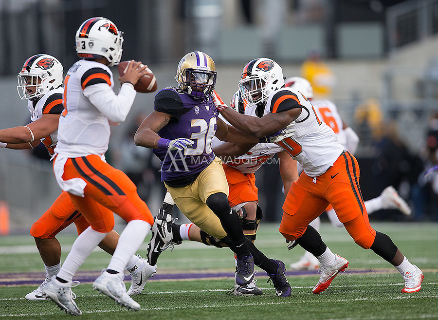 Azeem Victor applies pressure on Beaver quarterback Dwayne McMaryion, who ultimately threw an interception on the play.