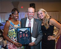 Herculaneum coach Jim Kasten poses with Jackie Joyner-Kersee and Brittany Borman after winning the auction for a Joyner-Kersee signed USA Track and Field jersey at the 2013 Brittany Borman Olympic Celebration in Festus, MO. Friday, September 13.