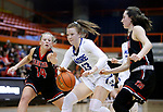February 28, 2020; Yankton at St. Thomas More High School Basketball -- Haleigh Timmer #13 of St. Thomas More drives between Yankton defenders during their game Friday evening at Barnett Arena in Rapid City, S.D.(Photo by Richard Carlson/Inertia)