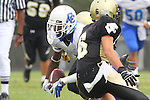 Palos Verdes, CA 09/16/11 - Julius Wilson (Culver City #4) and Matt Hezlep (Peninsula #6) in action during the Culver City-Peninsula varsity football game.