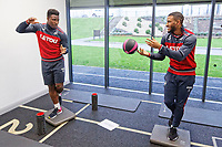(L-R) Tyler Reid and Luciano Narsingh exercise in the gym during the Swansea City Training at The Fairwood Training Ground, Swansea, Wales, UK. Thursday 04 January 2018