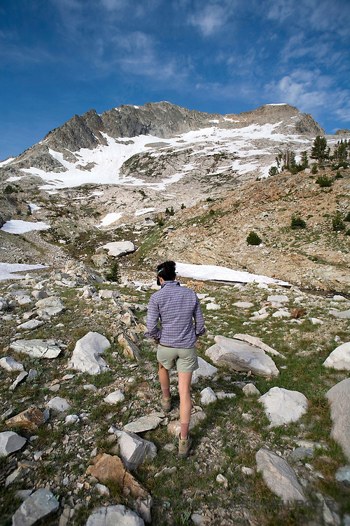 A woman approaching Snowyside Peak in the Sawtooth Wilderness of Idaho.