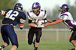 HARTFORD, SD - AUGUST 30:  Trevor McCabe #11 takes the hand off from Isaac Faldmo #10 of Dakota Valley as Sam Swier #42 from West Central closes in during the first quarter of their game Friday night at West Central. (Photo by Dave Eggen/Inertia)