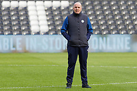 Paul Cook manager of Wigan Athletic stands on the pitch during the Sky Bet Championship match between Swansea City and Wigan Athletic at the Liberty Stadium, Swansea, Wales, UK. Saturday 19 January 2020