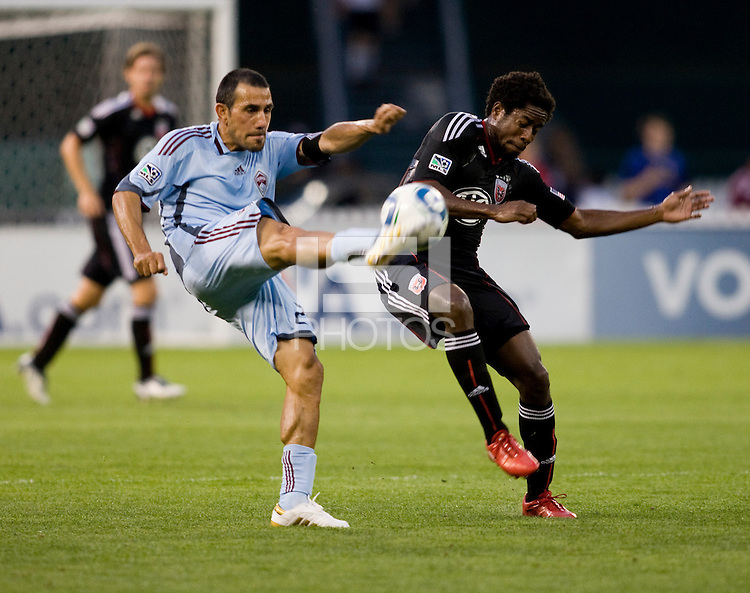 Clyde Simms (19) of D.C. United has the ball cleared away from him by Pablo Mastroeni (25) of the Colorado Rapids at RFK Stadium in Washington, DC.  The Colorado Rapids defeated D.C. United, 1-0.