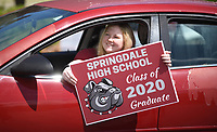 Sydney Hart, a graduating senior from Springdale High School, displays her sign for a photograph Monday, May 18, 2020, during the Springdale High School Bulldog Bash at the High School. Seniors were given the opportunity to drop off school materials, pick up signs and receive cords and awards. The event kicked off the 12 Days of Graduation event. Check out nwaonline.com/200519Daily/ and nwadg.com/photos for a photo gallery.<br /> (NWA Democrat-Gazette/David Gottschalk)