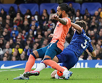 Everton's Theo Walcott is tackled by Chelsea's Marcos Alonso <br /> <br /> Photographer Stephanie Meek/CameraSport<br /> <br /> The Premier League - Chelsea v Everton - Sunday 8th March 2020 - Stamford Bridge - London<br /> <br /> World Copyright © 2020 CameraSport. All rights reserved. 43 Linden Ave. Countesthorpe. Leicester. England. LE8 5PG - Tel: +44 (0) 116 277 4147 - admin@camerasport.com - www.camerasport.com