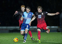 Stephen McGinn of Wycombe Wanderers holds off Jack McBean (right) of Coventry City & Ryan Haynes of Coventry City during the The Checkatrade Trophy Southern Group D match between Wycombe Wanderers and Coventry City at Adams Park, High Wycombe, England on 9 November 2016. Photo by Andy Rowland.