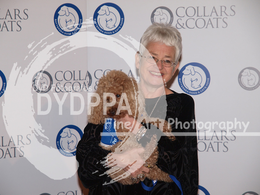 Author Dame Jacqueline Wilson with Billy the 4 year old toy poodle at  the Collars & Coats Gala ball, the Battersea Dogs Home, November 8, 2012. Photo by i-Images / DyD Fotografos