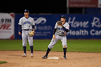 Lake County Captains middle infielders Tyler Freeman (7) and Daniel Schneemann (15) warm up between innings of a Midwest League game against the Beloit Snappers at Pohlman Field on May 6, 2019 in Beloit, Wisconsin. Lake County defeated Beloit 9-1. (Zachary Lucy/Four Seam Images)