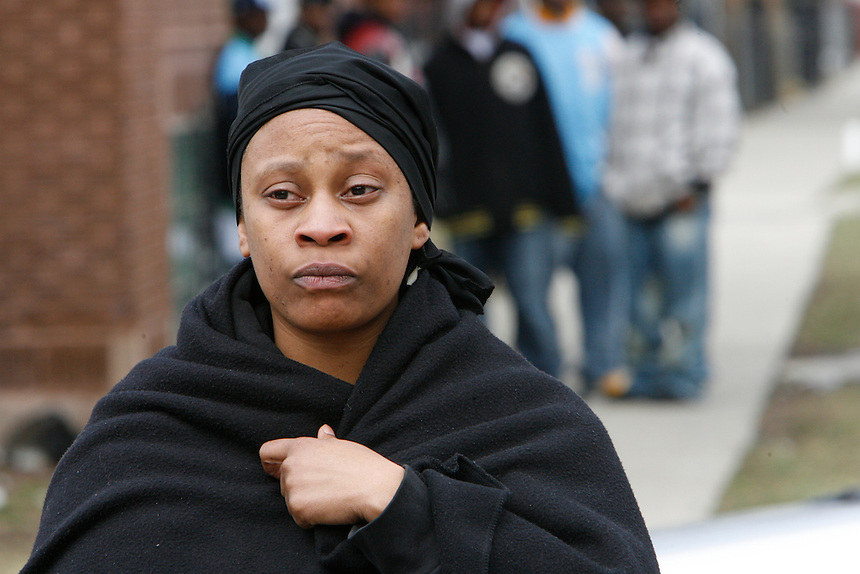 Tekoa Clark, who says she is the cousin of one of the deceased, watch as police investigate a triple homicide in the Englewood neighborhood at 6120 S. Hermatage, Friday, April 4, 2008. Chicago Tribune Photo by Charles Osgood   ..OUTSIDE TRIBUNE CO.- NO MAGS,  NO SALES, NO INTERNET, NO TV, CHICAGO OUT.. 00292137A TRIPLEHOMICIDE