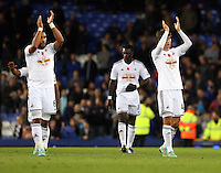 Liverpool, UK. Saturday 01 November 2014<br /> Pictured L-R: Swansea players Ashley Williams and Ki Sung Yueng thank their away supporters as they walk off the pitch after the end of the game. <br /> Re: Premier League Everton v Swansea City FC at Goodison Park, Liverpool, Merseyside, UK.