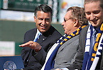 Reno Aces owner Herb Simon talks with Gov. Brian Sandoval before a ceremony announcing the addition of a United Soccer League franchise in Reno, Nev., on Wednesday, Sept. 16, 2015 at the Aces Ballpark. Reno Aces Team President Eric Edelstein is at right.<br /> Photo by Cathleen Allison