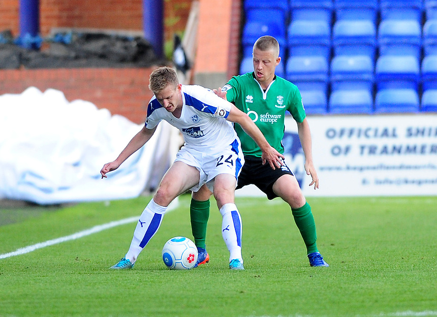 Tranmere Rovers' Jeff Hughes vies for possession with Lincoln City's Terry Hawkridge<br /> <br /> Photographer Andrew Vaughan/CameraSport<br /> <br /> Vanarama National League - Tranmere Rovers v Lincoln City - Saturday 10th September 2016 - Prenton Park - Birkenhead<br /> <br /> World Copyright &copy; 2016 CameraSport. All rights reserved. 43 Linden Ave. Countesthorpe. Leicester. England. LE8 5PG - Tel: +44 (0) 116 277 4147 - admin@camerasport.com - www.camerasport.com