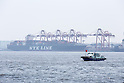 Tokyo, Japan - A boat passes by a cargo port in Tokyo, May 22, 2013. Japan posts a record-high of 879.9 billion yen ($8.6 billion USD) trade deficit for April as the weaker yen caused the increase the costs of imports.