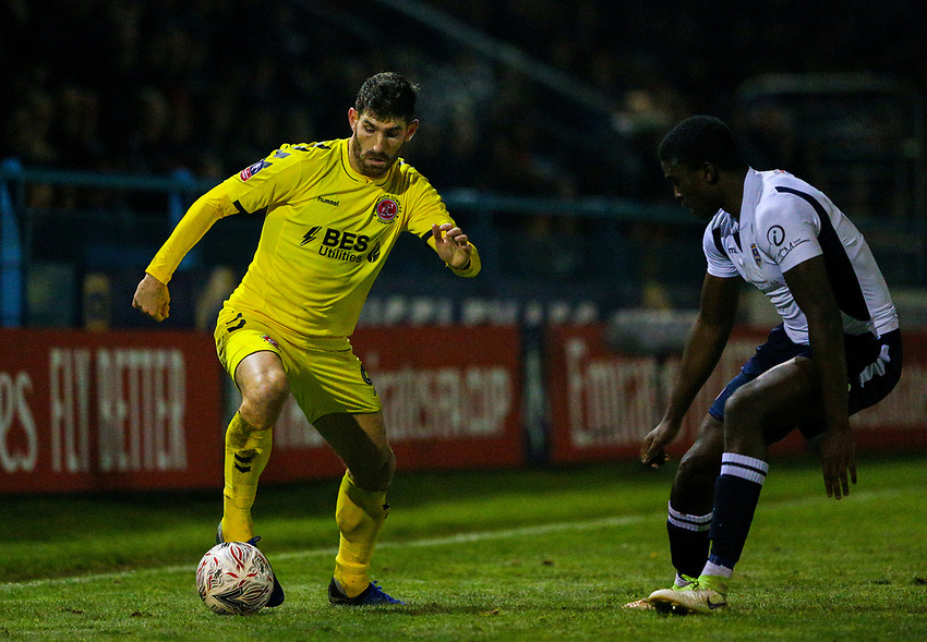 Fleetwood Town's Ched Evans takes on Guiseley's Cliff Moyo<br /> <br /> Photographer Alex Dodd/CameraSport<br /> <br /> The Emirates FA Cup Second Round - Guiseley v Fleetwood Town - Monday 3rd December 2018 - Nethermoor Park - Guiseley<br />  <br /> World Copyright © 2018 CameraSport. All rights reserved. 43 Linden Ave. Countesthorpe. Leicester. England. LE8 5PG - Tel: +44 (0) 116 277 4147 - admin@camerasport.com - www.camerasport.com