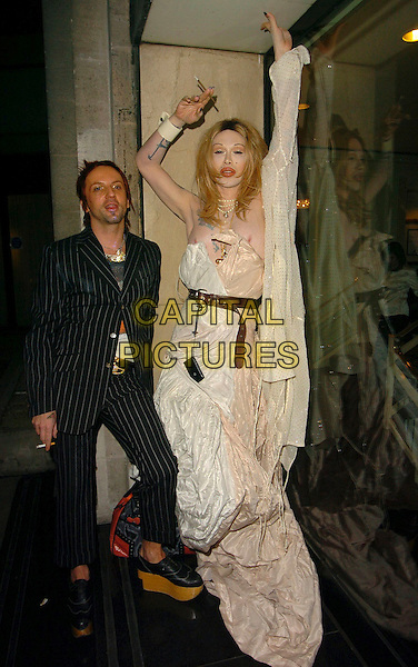 PETE BURNS & PARTNER.At the Miss Great Britain Awards,.Grosvenor House Hotel, London, .25th February 2006..full length wig tattoo tattooes smoking arms raised up white strapless dress belt.Ref: CAN.www.capitalpictures.com.sales@capitalpictures.com.©Capital Pictures