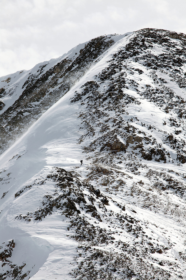 A lone climber heads towards the slopes of Grizzly Peak, Colorado.