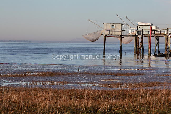 'Carrelets' or square fishing nets dropped from a wooden platform to catch plaice, in Talmont sur Gironde, on the Gironde Estuary, Aquitaine, France. Picture by Manuel Cohen