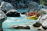 Julian Alps, Slovenia, July 2011. Rafting the rapids of the Soca river.  Slovenia boast a very spectacular carstic landscape with high limestone rock formations oozing with waterfalls, and fast flowing cristal clear waters that run through the Soca from the Triglav National Park to the Adriatic Sea. The Julian Alps are a paradise for outdoor adventure and adrenaline sports. The 3 centers for all activities are Bovec, Kobarid and Tolmin.  Photo by Frits Meyst/Adventure4ever.com