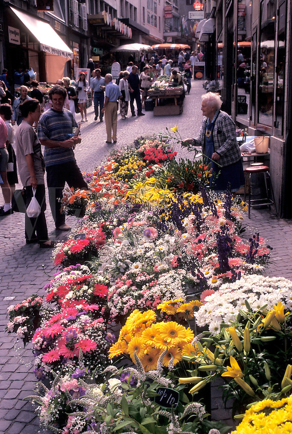 outdoor market, Switzerland, Lausanne, Vaud, Flowers for sale at the open air market in the city of Lausanne.