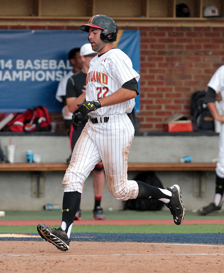 Maryland infielder Kyle Convissar (22) crosses the plate in the ninth inning of an NCAA college baseball tournament super regional game against Virginia in Charlottesville, Va., Sunday, June 8, 2014. Virginia defeat Maryland 7-3. (AP Photo/Andrew Shurtleff)