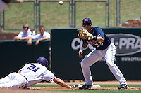First baseman Matt Snyder #33 of the Ole Miss Rebels on a pick off attempt during the NCAA Regional baseball game against the Texas Christian University Horned Frogs on June 1, 2012 at Blue Bell Park in College Station, Texas. Ole Miss defeated TCU 6-2. (Andrew Woolley/Four Seam Images)..
