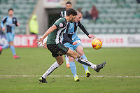 Michael Harriman of Wycombe Wanderers plays the ball around Kelvin Mellor of Plymouth Argyle during the Sky Bet League 2 match between Plymouth Argyle and Wycombe Wanderers at Home Park, Plymouth, England on 30 January 2016. Photo by Mark  Hawkins / PRiME Media Images.