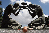 "A Voodoo doll under a statue at the entrance of Caracas cementery , part of an  essay by Howard Yanes The Borders of Faith in Venezuela. Howard says :""This are religions or beliefs from which no one speaks clearly but everydoby  knows they exist. Everybody pretends they are irrelevant, some of them even could laugh about this beliefs  but nobody would dare to remove those pieces of voodoo ceremony you can find at any cementery, or to close down the illegal shops selling animals for sacrifice."""