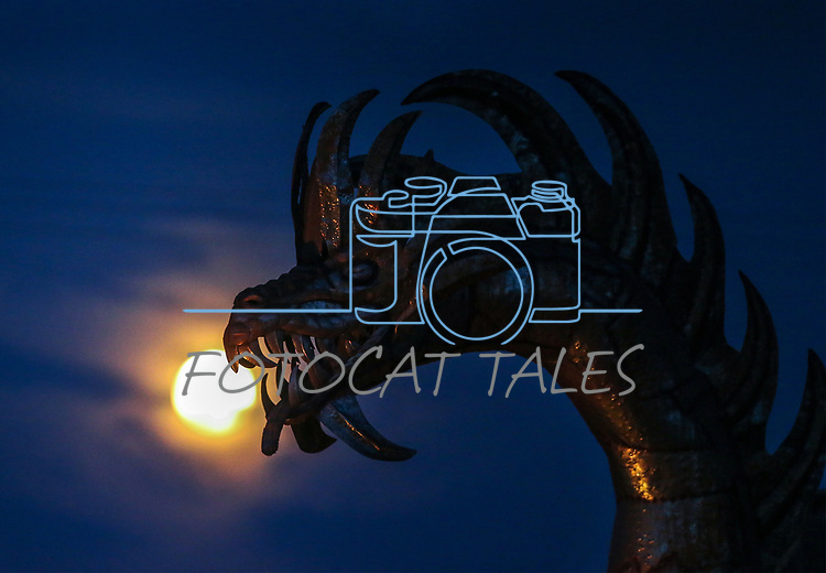 The moon rises behind a metal dragon sculpture in Gardnerville, Nev., on Saturday, Aug. 25, 2018. <br />Photo by Cathleen Allison/Nevada Momentum