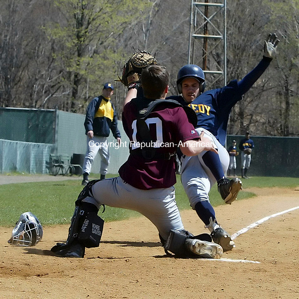 WATERBURY, CT-21 April 2006-042106TK07- (left to right:) A big 4th inning rally by Kennedy High School Nick Batista slide into home plate against Torrington High School catcher Greg Bodnar.   Tom Kabelka Republican-American