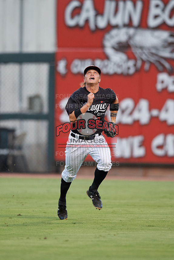 Birmingham Barons right fielder Alex Call (8) tracks a fly ball during a game against the Tennessee Smokies on August 16, 2018 at Regions FIeld in Birmingham, Alabama.  Tennessee defeated Birmingham 11-1.  (Mike Janes/Four Seam Images)