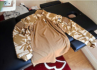 """Pictured: Army clothing recovered from the house of Kristen Brekke<br /> Re: Three men accused of helping a Cardiff teenager travel to Syria to fight with Islamic extremists are facing jail.<br /> Kristen Brekke, 20, from Cardiff, Forhad Rahman, from Cirencester, and Adeel Ulhaq, from Nottinghamshire, have been found guilty of helping in the preparation of an act of terrorism.<br /> The Old Bailey heard they helped Aseel Muthana, 19, join so-called Islamic State terrorists in February 2014.<br /> The court heard the defendants shared the same """"highly-radical ideology"""".<br /> They will be sentenced later on Wednesday."""