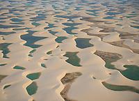Rainwater  ponds trapped in white dunes, Lencois Maranhenses National Park, Brazil, Atlantic Ocean