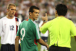 7 February 2007: Referee Mauricio Navarro (right) talks to Mexico's Jared Borgetti (9) during the first half. The United States National Team defeated Mexico 2-0 at University of Phoenix Stadium in Glendale, Arizona in an International Friendly soccer match.