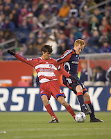 FC Dallas midfielder Pablo Ricchetti (6) dribbles as New England Revolution midfielder/defender Jeff Larentowicz (13) defends. The New England Revolution defeated FC Dallas, 2-1, at Gillette Stadium on April 4, 2009. Photo by Andrew Katsampes /isiphotos.com