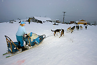 DeeDee Jonrowe Runs Up Bank of Yukon River @ Kaltag Chkpt 2005 Iditarod