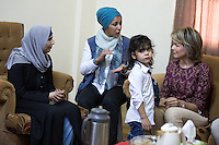 Queen Mathilde of Belgium during a visit of refugee family's home in Mafraq - Jordan
